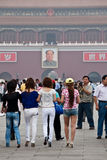 Chinese girls and Chairman Mao portrait Royalty Free Stock Image