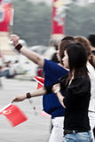 Chinese girls with flags Royalty Free Stock Image