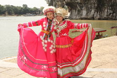 Chinese girls in traditional dresses. Nice chinese girls in beautiful red traditional dresses, Guiling, China - August 3, 2010 stock photo