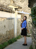 Chinese girls wear student clothes in Republic of China. Hold Oiled paper umbrella,Standing in a small alley in Hongcun,Ancient Villages in Southern Anhui stock photography