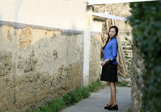 Chinese girls wear student clothes in Republic of China. Hold Oiled paper umbrella,Standing in a small alley in Hongcun,Ancient Villages in Southern Anhui royalty free stock image