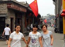 Chinese girls at Yandan Pipe hutong in Beijing, China Stock Photo