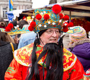 Chinese god of fortune. LONDON - FEBRUARY 22nd: The god of fortune at the Chinese new year celebrations on February the 22nd, 2015, in London, England, UK Royalty Free Stock Photography