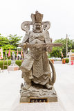 Chinese god statue with his sword. Chinese god statue, with his sword, around Chinese shrine, Phuket, Thailand Stock Image