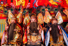 Chinese god statues in red shrine. Stock Photos