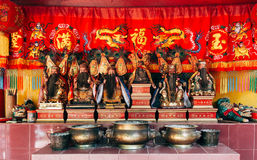 Chinese god statues in red shrine. Royalty Free Stock Photos