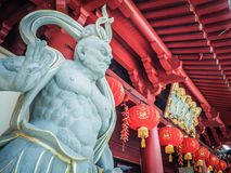 Chinese God stone statue in front of Buddha Tooth Relic Temple royalty free stock photos