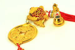 Chinese gold amulet with gold replica lantern Royalty Free Stock Photo
