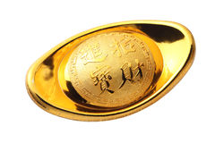 Chinese gold ingot. On white background stock photography