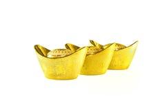 Chinese gold ingots. Decoration of chinese gold ingots isolated on white background Stock Photos