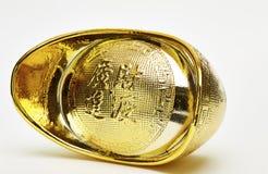 Chinese gold ingots isolated. On white background royalty free stock photos