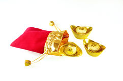 Chinese gold ingots with red packet. With isolated white background stock images
