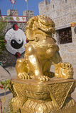Chinese gold lion in the town of Pai Stock Images