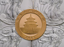 Chinese Gold Panda ontop of US Silver Eagles Royalty Free Stock Images