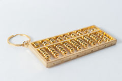 Chinese golden abacus. On isolate Royalty Free Stock Image