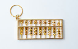 Chinese golden abacus. On isolate Stock Images