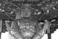 Chinese golden Buddha statue faith black white Stock Photo