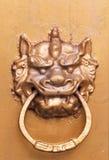 Chinese golden colored door knocker Stock Image
