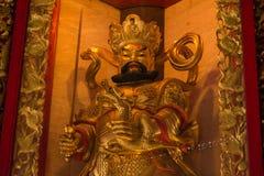The Chinese golden goddess statue at Wat Borom Raja Kanjanapisek Stock Images