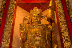 The Chinese golden goddess statue at Wat Borom Raja Kanjanapisek Stock Photo