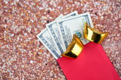 Chinese golden ingots red packet,Chinese new year festival decorations concept.  stock photography