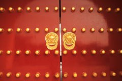 Chinese golden lion on red door. Closed Royalty Free Stock Photo