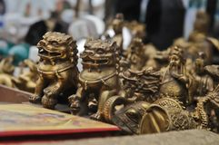 Chinese golden lion small statues. Chinese golden fairytail vintage old classical lions small size statues Royalty Free Stock Photo