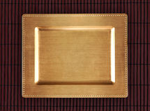 Chinese golden tray on the bamboo table. Eastern background for food. Royalty Free Stock Photo