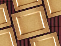 Chinese golden tray on the bamboo table. Eastern background for food. Stock Photos