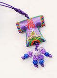 Chinese good luck pendant. Chinese purple and blue good luck pendant royalty free stock photo
