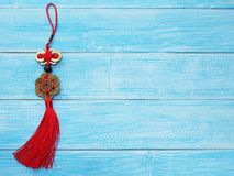Chinese good luck symbol on wooden blue background. Chinese new year ornament and background, China good luck symbol on wooden blue table royalty free stock photo