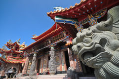 Chinese grand palace and stone guardian lion Stock Photos