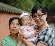 Chinese grandma mother and baby. In the park Stock Image
