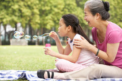 Chinese Grandmother With Granddaughter In Park Stock Photos