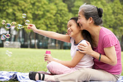 Chinese Grandmother With Granddaughter In Park Stock Image