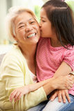 Chinese Grandmother And Granddaughter Relaxing Royalty Free Stock Photo