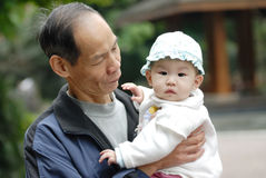 Chinese grandpa and baby Stock Images