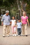 Chinese Grandparents Walking Through Park Stock Photography