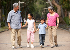 Chinese Grandparents Walking Through Park stock images