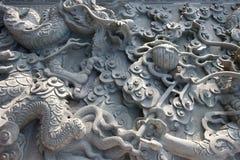 Chinese granite wall texture. Chinese dragons on granite wall texture Royalty Free Stock Photos