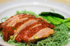 Chinese green noodle with roast duck and vegetable.  Stock Photo