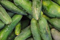 Chinese green papayas at the market Royalty Free Stock Images