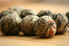 Chinese green tea balls with jasmine flowers Royalty Free Stock Photos