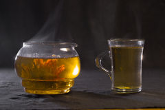 Chinese green tea Bud blooms in a glass teapot. A Cup of tea Stock Photography