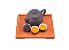 Chinese green tea clay pot and cups. On bamboo wood tray isolated over white Royalty Free Stock Photography