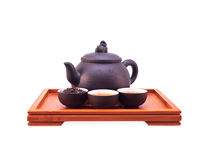 Chinese green tea clay pot and cups. On bamboo wood tray isolated over white Royalty Free Stock Photos