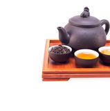 Chinese green tea clay pot and cups. On bamboo wood tray isolated over white Stock Photo