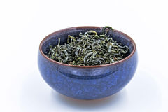 Chinese Green tea. Huang Shan Mao Feng in a blue ceramic bowl. Isolated on white Royalty Free Stock Image