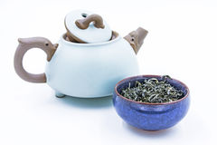 Chinese Green tea. Huang Shan Mao Feng in a blue ceramic bowl. With small clay pot isolated on white Royalty Free Stock Photo