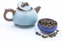 Chinese green tea Jasmine Pearl. Mo Li Long Zhu in a blue ceramic bowl with small clay pot isolated on white Stock Photos